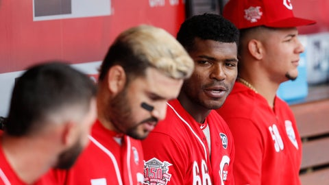 <p>               Cincinnati Reds right fielder Yasiel Puig (66) sits with his teammates in the dugout in the second inning of a baseball game against the Miami Marlins, Thursday, April 11, 2019, in Cincinnati. (AP Photo/John Minchillo)             </p>