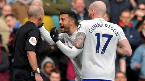 <p>               Cardiff City's Victor Camarasa confronts referee Mike Dean after he awards a penalty before overturning the decision during the English Premier League soccer match between Burnley and Cardiff Ciry at Turf Moor, Burnley, England, Saturday, April 13, 2019. (Anthony Devlin/PA via AP)             </p>