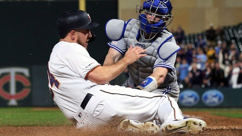 <p>               Minnesota Twins' C.J. Cron, left, is tagged out at the plate by Toronto Blue Jays catcher Danny Jansen for the final out to end the baseball game, Tuesday, April 16, 2019, in Minneapolis. The Blue Jays won 6-5. (AP Photo/Jim Mone)             </p>