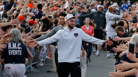 <p>               Ty Jerome and other members of the Virginia basketball team are welcomed by fans as they return home after their win of the championship in the Final Four NCAA college basketball tournament against Texas Tech, in Charlottesville, Va., Tuesday, April 9, 2019. (AP Photo/Steve Helber)             </p>