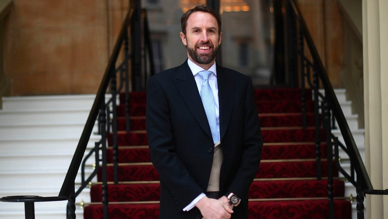 Back in his vest, Southgate gets honor at Buckingham Palace