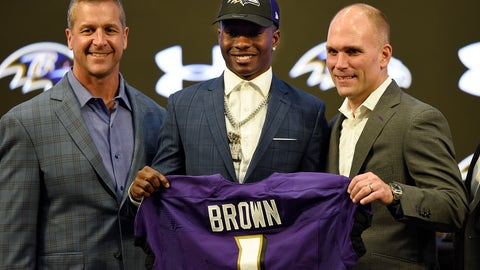 <p>               Baltimore Ravens NFL football first round draft pick Marquise Brown, center, stands with head coach John Harbaugh, left, and Executive Vice President/General Manager Eric DeCosta Friday, April 26, 2019, in Owings Mills, Md. (AP Photo/Gail Burton)             </p>