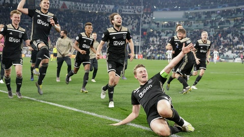<p>               Ajax's Matthijs de Ligt and teammates celebrate at the end of the Champions League, quarterfinal, second leg soccer match between Juventus and Ajax, at the Allianz stadium in Turin, Italy, Tuesday, April 16, 2019. Ajax won 2-1 and advances to the semifinal on a 3-2 aggregate. (AP Photo/Luca Bruno)             </p>
