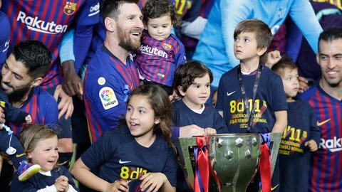 <p>               Barcelona forward Lionel Messi with his children pose with the trophy after winning the Spanish League title, at the end of the Spanish La Liga soccer match between FC Barcelona and Levante at the Camp Nou stadium in Barcelona, Spain, Saturday, April 27, 2019. Barcelona clinched the Spanish La Liga title, with three matches to spare, after it defeated Levante 1-0. (AP Photo/Manu Fernandez)             </p>
