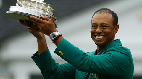<p>               Tiger Woods wears his green jacket holding the winning trophy after the final round for the Masters golf tournament Sunday, April 14, 2019, in Augusta, Ga. (AP Photo/Matt Slocum)             </p>