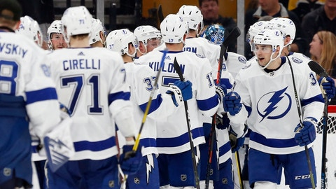<p>               Tampa Bay Lightning's Cameron Gaunce (33) celebrates with teammates after defeating the Boston Bruins in an NHL hockey game in Boston, Saturday, April 6, 2019. (AP Photo/Michael Dwyer)             </p>