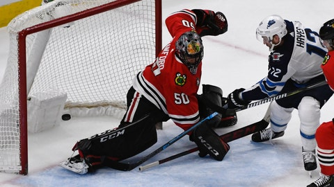 <p>               Winnipeg Jets right wing Kevin Hayes (12) scores the winning goal in overtime past Chicago Blackhawks goaltender Corey Crawford (50) during an NHL hockey game Monday, April 1, 2019, in Chicago. (AP Photo/Matt Marton)             </p>