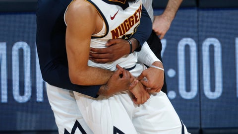 <p>               Denver Nuggets forward Torrey Craig, back, hugs guard Jamal Murray after he hit a key basket late in the second half of Game 2 of an NBA basketball playoff series against the San Antonio Spurs, Tuesday, April 16, 2019, in Denver. The Nuggets won 114-105. (AP Photo/David Zalubowski)             </p>