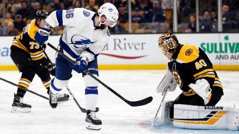 <p>               Tampa Bay Lightning's Nikita Kucherov (86) scores on Boston Bruins' Tuukka Rask (40) during the third period of an NHL hockey game in Boston, Saturday, April 6, 2019. (AP Photo/Michael Dwyer)             </p>