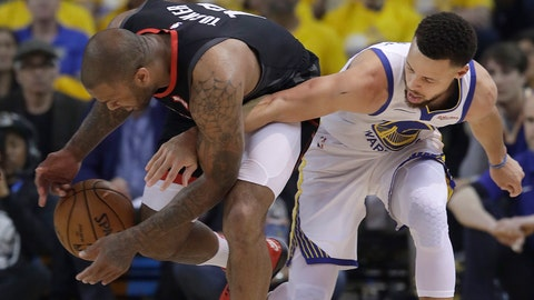 <p>               Houston Rockets forward PJ Tucker, left, grabs the ball next to Golden State Warriors guard Stephen Curry during the first half of Game 1 of a second-round NBA basketball playoff series in Oakland, Calif., Sunday, April 28, 2019. (AP Photo/Jeff Chiu)             </p>