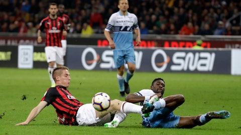 <p>               AC Milan's Andrea Conti, left, and Lazio's Quissanga Bastos challenge for the ball during the Italian Cup, second leg semifinal soccer match between AC Milan and Lazio, at the San Siro stadium, in Milan, Italy, Wednesday, April 24, 2019. (AP Photo/Luca Bruno)             </p>