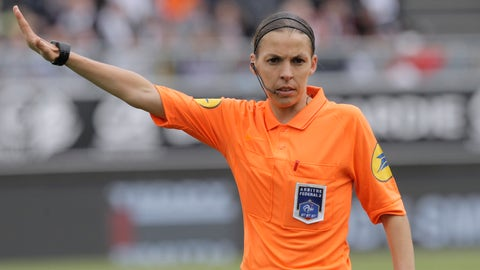 <p>               French referee Stephanie Frappart gestures during her French League One soccer match between Amiens and Strasbourg, at the Stade de la Licorne stadium in Amiens, France, Sunday, April 28, 2019. Stephanie Frappart is the first woman to referee a Ligue One soccer match in France. (AP Photo/Michel Spingler)             </p>