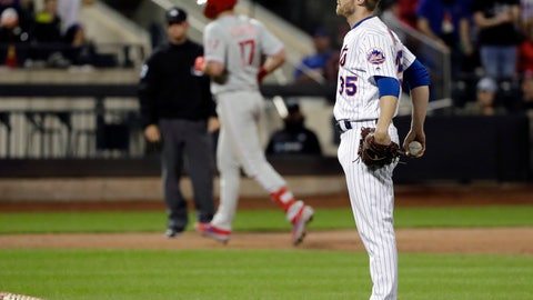 <p>               New York Mets relief pitcher Jacob Rhame, right, reacts as Philadelphia Phillies' Rhys Hoskins runs the bases after hitting a two-run home run during the ninth inning of a baseball game, Wednesday, April 24, 2019, in New York. (AP Photo/Frank Franklin II)             </p>
