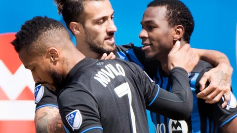<p>               Montreal Impact's Omar Browne, right, celebrates with teammates Maximiliano Urruti, center, and Harry Novillo after scoring against the Chicago Fire during second-half MLS soccer match action in Montreal, Sunday, April 28, 2019. (Graham Hughes/The Canadian Press via AP)             </p>