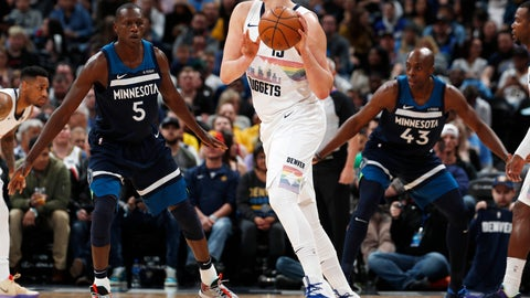 <p>               Denver Nuggets center Nikola Jokic, center, looks to pass the ball as Minnesota Timberwolves center Gorgui Dieng, left, and Anthony Tolliver defend during the first half of an NBA basketball game Wednesday, April 10, 2019, in Denver. (AP Photo/David Zalubowski)             </p>