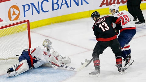<p>               Carolina Hurricanes' Warren Foegele (13) scores against Washington Capitals goalie Braden Holtby (70) while Capitals' Lars Eller (20) defends during the second period of Game 3 of an NHL hockey first-round playoff series in Raleigh, N.C., Monday, April 15, 2019. (AP Photo/Gerry Broome)             </p>