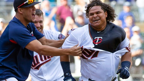 "<p>               FILE - In this Sept. 9, 2018, file photo, Minnesota Twins' Willians Astudillo, right, is mobbed by teammate Jose Berrios after hitting a 2-run home run during the ninth inning of a baseball game against the Kansas City Royals, in Minneapolis. The most popular player on the first-place Minnesota Twins is the third-string catcher and versatile everyman Willians Astudillo, whose all-out style has endeared him to the team and the fans since his debut last season. His cult hero status reaches a new high on Friday night, when the Twins give away ""La Tortuga"" T-shirts in honor of his nickname, which means turtle in Spanish, at their game against Baltimore. (AP Photo/Paul Battaglia, File)             </p>"