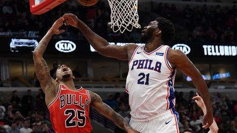 <p>               Philadelphia 76ers center Joel Embiid (21) defends Chicago Bulls guard Walt Lemon Jr. (25) during the second half of an NBA basketball game Saturday, April 6, 2019, in Chicago. The 76ers won 116-96. (AP Photo/David Banks)             </p>