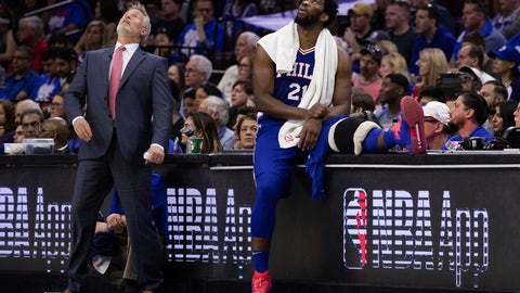 <p>               Philadelphia 76ers head coach Brett Brown, left, and Joel Embiid, right, of Cameroon, look up at the scoreboard during the first half in Game 1 of a first-round NBA basketball playoff series against the Brooklyn Nets, Saturday, April 13, 2019, in Philadelphia. The Nets won 111-102. (AP Photo/Chris Szagola)             </p>