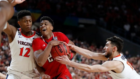<p>               Texas Tech's Jarrett Culver (23) drives against Virginia's Ty Jerome (11) and De'Andre Hunter (12) during the overtime in the championship of the Final Four NCAA college basketball tournament, Monday, April 8, 2019, in Minneapolis. (AP Photo/Jeff Roberson)             </p>