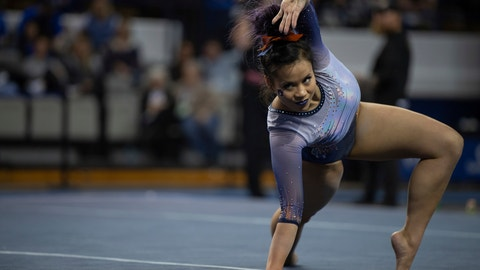 """<p>               FILE - In this Feb. 1, 2019, file photo, Auburn's Samantha Cerio performs a floor routine during an NCAA gymnastics meet against Kentucky,in Lexington, Ky. Cerio is asking social media to stop sharing the video of her devastating leg injuries because """"my pain is not your entertainment."""" Auburn senior Samantha Cerio wrote on Twitter Wednesday, April 10, that seeing her """"knees bent unnaturally in real life was horrible enough,"""" but she says continuing to see the video and photos because people feel entitled to repost them """"is not okay.""""(AP Photo/Bryan Woolston, File)             </p>"""