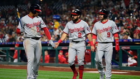 <p>               Washington Nationals' Adam Eaton, center, high-fives Juan Soto, left, after Brian Dozier, right, as Eaton scored on a double hit by Anthony Rendon during the fourth inning of a baseball game against the Philadelphia Phillies, Wednesday, April 10, 2019, in Philadelphia. (AP Photo/Derik Hamilton)             </p>