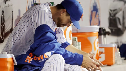 <p>               New York Mets starting pitcher Jacob deGrom, last year's National League Cy Young award winner, sits in the dugout after allowing six runs during the first four innings of an interleague baseball game against the Minnesota Twins, Tuesday, April 9, 2019, in New York. (AP Photo/Kathy Willens)             </p>
