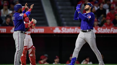 <p>               Texas Rangers' Joey Gallo, right, gestures as he scores after hitting a three-run home run as Elvis Andrus, left, waits to congratulate him and Los Angeles Angels catcher Jonathan Lucroy stands at the plate during the first inning of a baseball game Thursday, April 4, 2019, in Anaheim, Calif. (AP Photo/Mark J. Terrill)             </p>