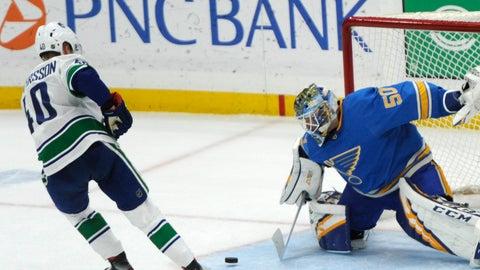 <p>               St. Louis Blues goalie Jordan Binnington (50) blocks a shot in a shootout by Vancouver Canucks' Elias Pettersson (40), of Sweden, in an NHL hockey game, Saturday, April 6, 2019, in St. Louis. (AP Photo/Bill Boyce)             </p>