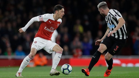 <p>               Arsenal's Mesut Ozil, left, competes for the ball with Newcastle's Paul Dummett during the English Premier League soccer match between Arsenal and Newcastle United at Emirates stadium in London, Monday, April 1, 2019. (AP Photo/Kirsty Wigglesworth)             </p>