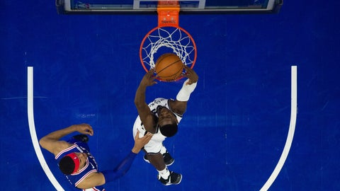 <p>               Brooklyn Nets' Caris LeVert, right, dunks the ball as Philadelphia 76ers' Tobias Harris, left, defends during the first half in Game 1 of a first-round NBA basketball playoff series, Saturday, April 13, 2019, in Philadelphia. (AP Photo/Chris Szagola)             </p>