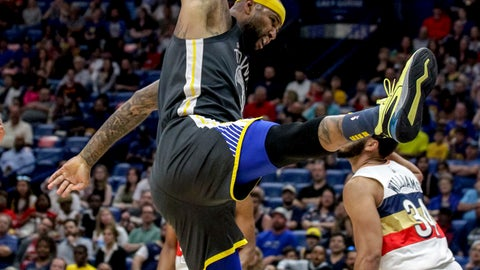 <p>               Golden State Warriors center DeMarcus Cousins (0) dunks over New Orleans Pelicans guard Kenrich Williams (34) in the first half of an NBA basketball game in New Orleans, Tuesday, April 9, 2019. (AP Photo/Scott Threlkeld)             </p>