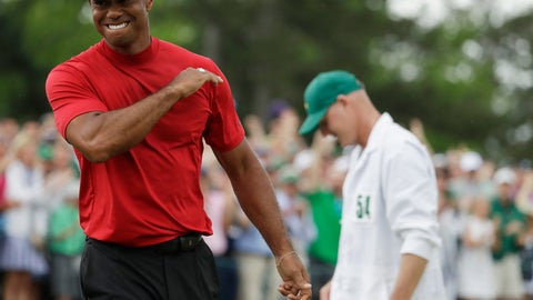 <p>               Tiger Woods reacts as he wins the Masters golf tournament Sunday, April 14, 2019, in Augusta, Ga. (AP Photo/Chris Carlson)             </p>