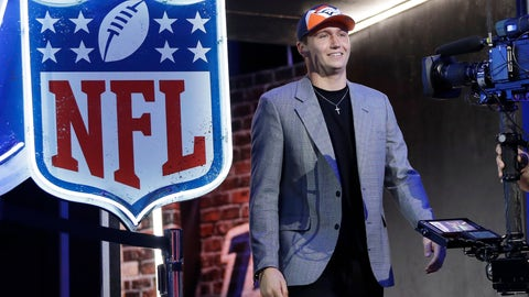 <p>               Missouri quarterback Drew Lock enteres the stage after the Denver Broncos selected Lock during the second round of the NFL football draft, Friday, April 26, 2019, in Nashville, Tenn. (AP Photo/Mark Humphrey)             </p>