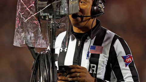 "<p>               FILE - In this Nov. 3, 2018, file photo, referee Reggie Smith reviews a targeting penalty during the first half of an NCAA college football game in Lubbock, Texas. The NCAA Playing Rules Oversight Panel adjusted the targeting rule in college football, allowing video review officials to overturn calls if any element of the penalty cannot be confirmed. The adjustment to the rule announced Tuesday, April 23, 2019, means there will be no option for letting the call on the field ""stand"" during a targeting review. It must either be confirmed or overturned. (AP Photo/Brad Tollefson, File)             </p>"