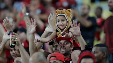 <p>               Fans of Brazil's Flamengo soccer team cheer before a Copa Libertadores soccer match against Uruguay's Penarol at Maracana stadium in Rio de Janeiro, Brazil, Wednesday, April 3, 2019. (AP Photo/Silvia Izquierdo)             </p>