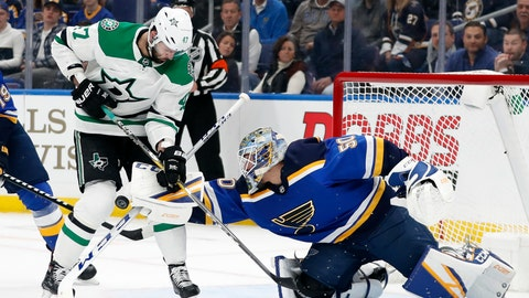 <p>               Dallas Stars' Alexander Radulov (47) pressures the net as St. Louis Blues goaltender Jordan Binnington (50) attempts to clear an airborne puck during the first period in Game 1 of an NHL second-round hockey playoff series Thursday, April 25, 2019, in St. Louis. (AP Photo/Jeff Roberson)             </p>