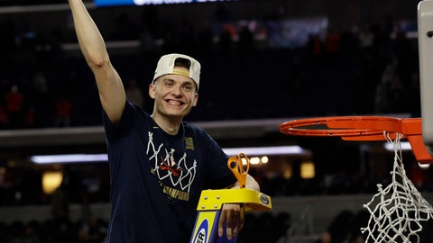 <p>               Virginia's Kyle Guy celebrate after defeating Texas Tech 85-77 in the overtime in the championship of the Final Four NCAA college basketball tournament, Monday, April 8, 2019, in Minneapolis. (AP Photo/David J. Phillip)             </p>