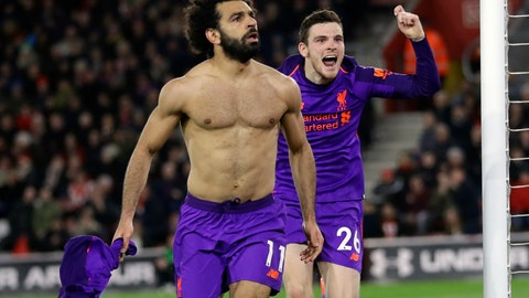 <p>               Liverpool's Mohamed Salah, left, celebrates after scoring his side's second goal during the English Premier League soccer match between Southampton and Liverpool at St Mary's stadium in Southampton, England Friday, April 5, 2019. (AP Photo/Kirsty Wigglesworth)             </p>