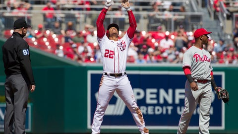 <p>               Washington Nationals' Juan Soto (22) celebrates his hit for a double with Philadelphia Phillies shortstop Jean Segura (2) covering second base, during the first inning of a baseball game at Nationals Park, Wednesday, April 3, 2019, in Washington. (AP Photo/Alex Brandon)             </p>