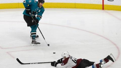<p>               San Jose Sharks center Joe Thornton, top, passes the puck against Colorado Avalanche defenseman Samuel Girard during the third period of an NHL hockey game in San Jose, Calif., Saturday, April 6, 2019. (AP Photo/Jeff Chiu)             </p>