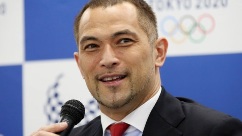 <p>               Tokyo 2020 Sports Director Koji Murofushi speaks during a press conference to unveil detailed Olympic competition schedule in Tokyo, Tuesday, April 16, 2019. For fans, athletes, and volunteers in Japan, next year's Olympics in Tokyo could become known as the get-up-early games.Organizers announced Tuesday that - hoping to beat summer heat in the Japanese capital - the men's 50-meter race walk final will begin at 5:30 a.m. The men's and women's marathon final will start at 6 a.m. (AP Photo/Koji Sasahara)             </p>