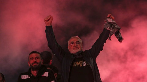 <p>               PAOK chairman Ivan Savvidis celebrates with fans the Greek Super League championship title in front of the White Tower, in Thessaloniki, northern Greece, early Monday, April 22, 2019. PAOK won the Greek league with a round to spare after beating Levadiakos 5-0, 34 years after the last time the team won the championship. (AP Photo/Giannis Papanikos)             </p>