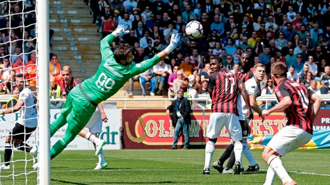<p>               AC Milan's Gianluigi Donnarumma, left, makes a save during a Serie A soccer match between Parma and AC Milan at the Ennio Tardini Stadium in Parma, Italy, Saturday, April 20, 2019. (Elisabetta Baracchi/ANSA via AP)             </p>