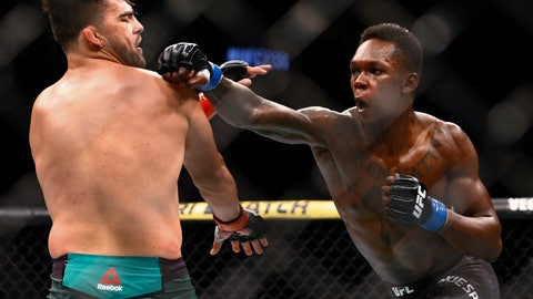 <p>               Kelvin Gastelum and Israel Adesanya fight during a middleweight mixed martial arts bout at UFC 236 in Atlanta on Saturday, April 13, 2019. (AP Photo/Michael Zarrilli)             </p>