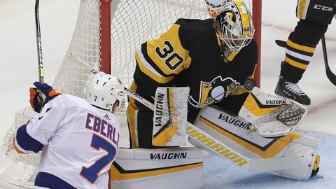 <p>               Pittsburgh Penguins goaltender Matt Murray (30) stops a shot by New York Islanders' Jordan Eberle (7) during the first period in Game 3 of an NHL first-round hockey playoff series in Pittsburgh, Sunday, April 14, 2019. (AP Photo/Gene J. Puskar)             </p>