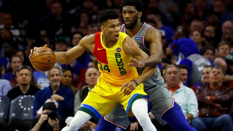<p>               Milwaukee Bucks' Giannis Antetokounmpo, left, tries to drive past Philadelphia 76ers' Joel Embiid during the first half of an NBA basketball game, Thursday, April 4, 2019, in Philadelphia. (AP Photo/Matt Slocum)             </p>