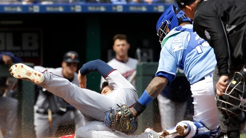 <p>               Minnesota Twins' Jake Cave (60) is tagged out at home by Kansas City Royals catcher Martin Maldonado as he tried to score on an RBI double by Mitch Garver during the fourth inning of a baseball game Wednesday, April 3, 2019, in Kansas City, Mo. (AP Photo/Charlie Riedel)             </p>