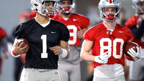 <p>               FILE - In this March 6, 2019, file photo, Ohio State quarterback Justin Fields, left, and wide receiver K.J. Hill run through a drill during the NCAA college football team's practice in Columbus, Ohio. First-year coach Ryan Day of defending conference champion Ohio State insisted after the Buckeyes' spring game last Saturday he hadn't decided between Georgia transfer Justin Fields and redshirt freshman Matthew Baldwin, who spent much of last season rehabbing a knee injury. Baldwin announced he would transfer on Thursday, April 18, 2019, erasing any doubt that Fields, the biggest acquisition of the offseason, would be the starter. (AP Photo/Paul Vernon, File)             </p>