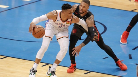 <p>               Oklahoma City Thunder guard Russell Westbrook (0) drives to the basket as Portland Trail Blazers guard Damian Lillard (0) defends in the first half of Game 4 of an NBA basketball first-round playoff series Sunday, April 21, 2019, in Oklahoma City. (AP Photo/Alonzo Adams)             </p>